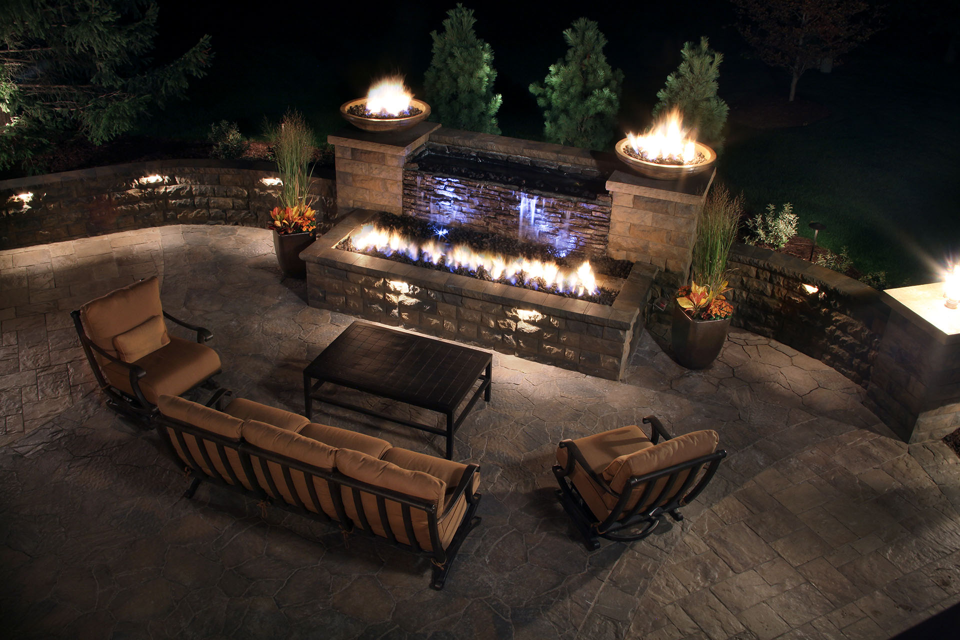 But The Water Fire Feature Is Just A Starting Point For This Patio Which Stretches Out To Encomp An Outdoor Kitchen With Bar Seating And Plenty Of Room